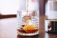 Fruit brandy being poured into a glass; Photo by StockSnap, Burst