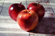 Red apples on wooden floor; Photo by Pexels, Suzy Hazelwood